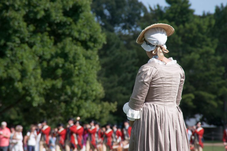 Re-enactor awaits the coming of the fife & drums corps in Williamsburg, VA