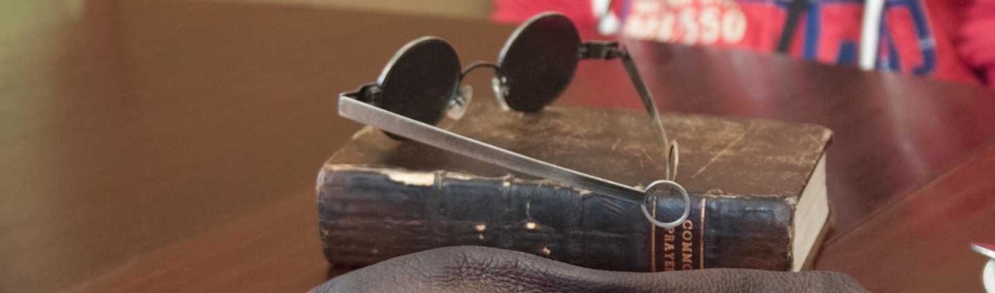 Vintage Book of Common Prayer, and colonial sunglasses