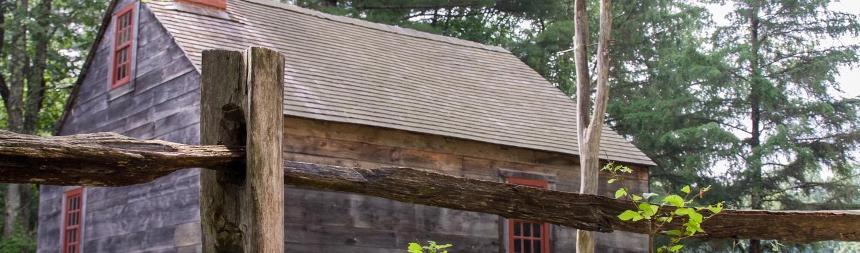Rail fence around a house in Sturbridge Village, MA