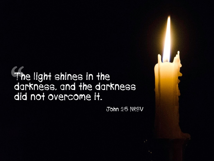 John 1:5, NRSV with single lit candle