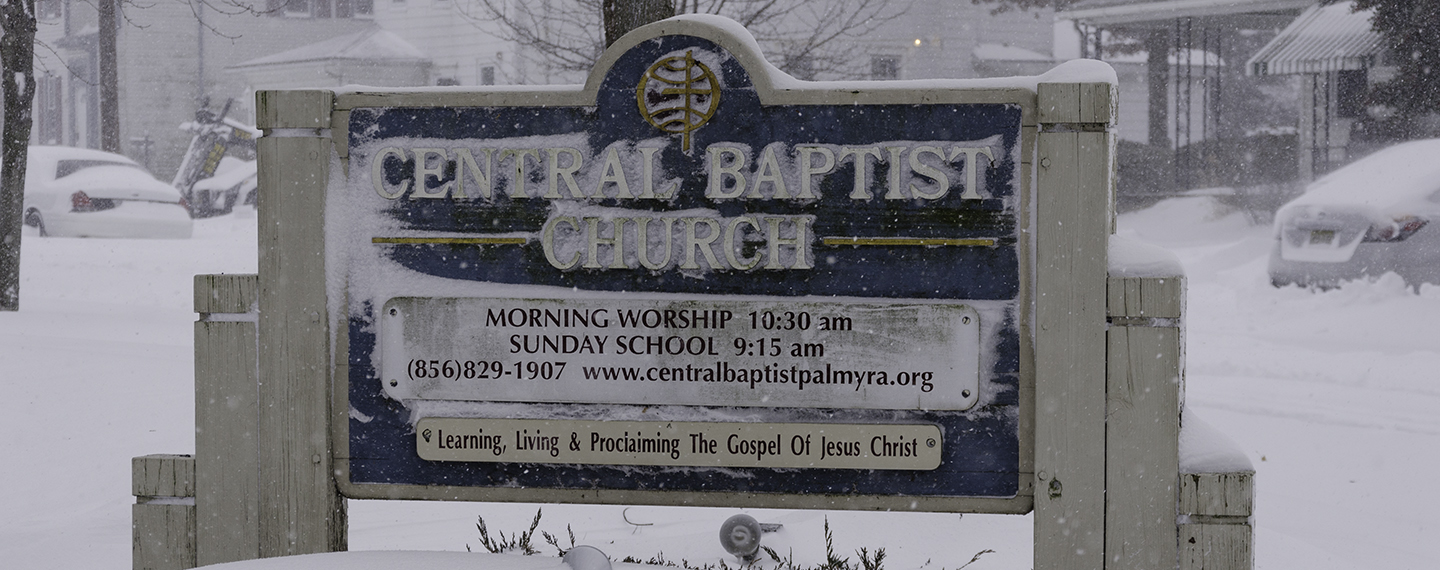 Central Baptist Sign, covered in snow