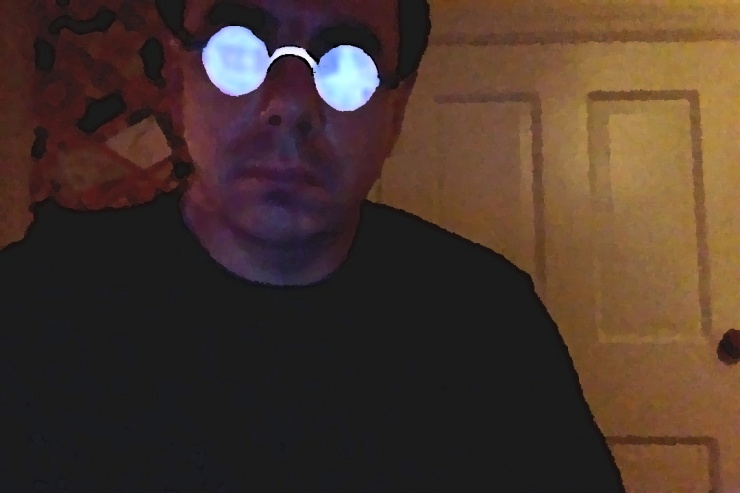 Computer Screen reflecting off my glasses, causing a glow.