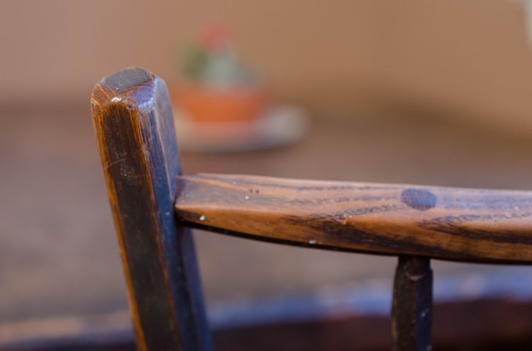 A weathered chair and table, passed on to me from my childhood home.