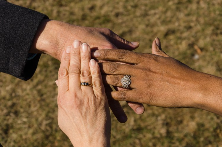 Diverse hands, reaching out with compassion