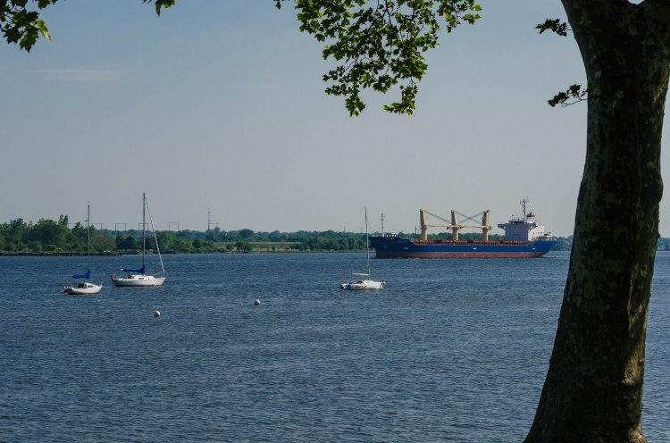 A cargo ship navigates down the Delaware.