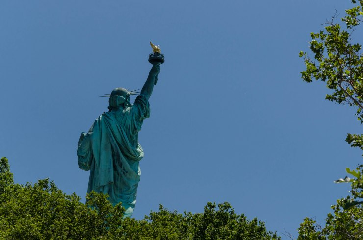 Lady Liberty rises from the trees