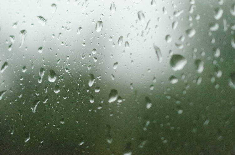 window splashed with water droplets