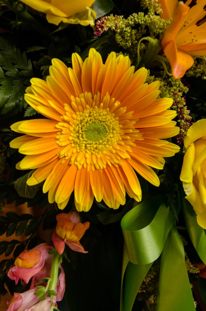 fall flowers in a funeral arrangement