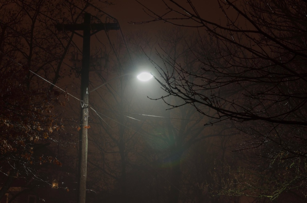 Street light, glowing in the fog