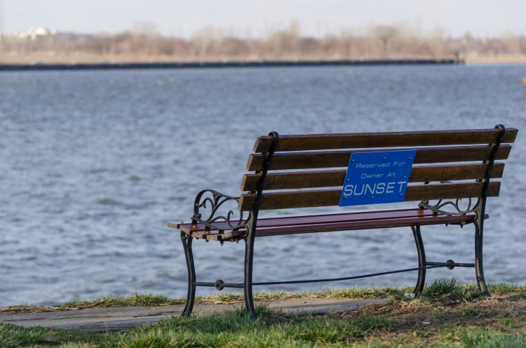 Bench along the Delaware reading - reserved for owner at sunset