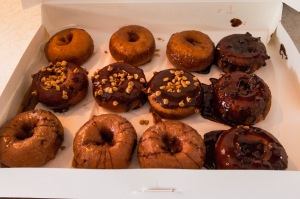 A dozen beautiful donuts.