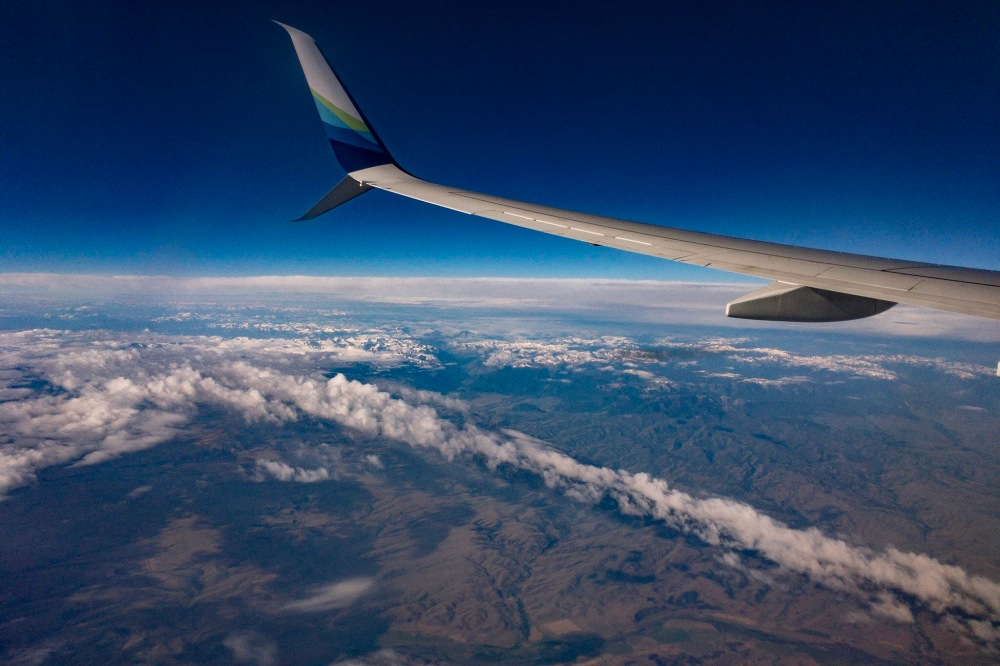 Airplane Wing, high above the clouds