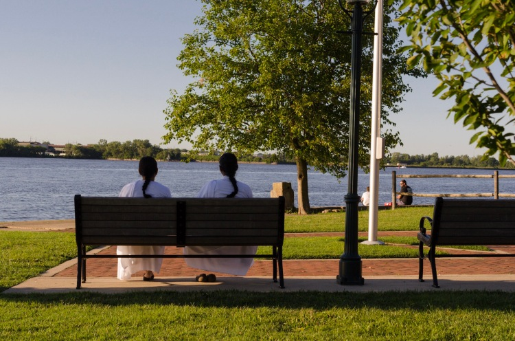 Two women on a bench overlooking the Delaware