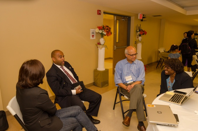 Pastors gather to share their stories.
