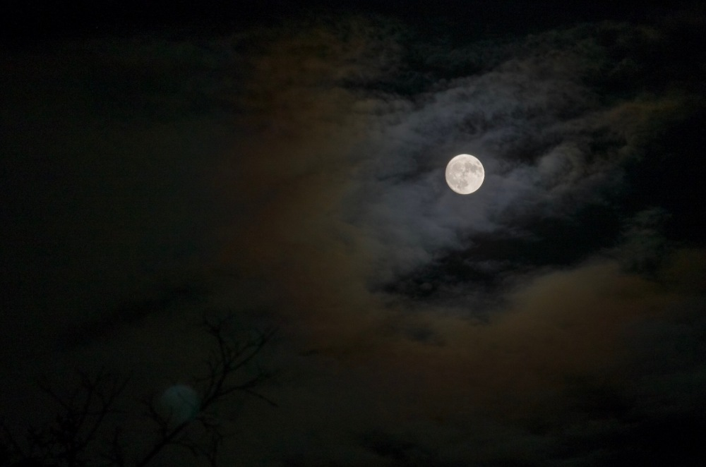 A full moon in clouds