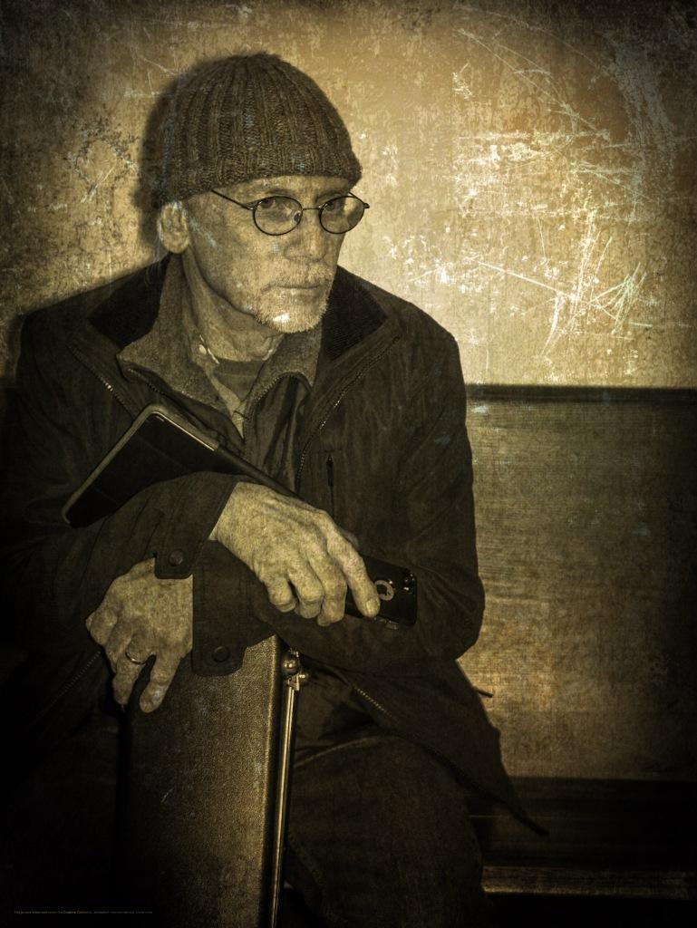 A musician leans forward
