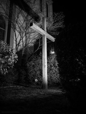Black and white photo of an illuminated cross