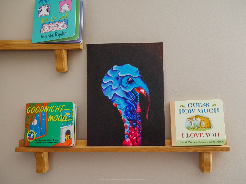 Painting of a turkey, nestled in among children's books