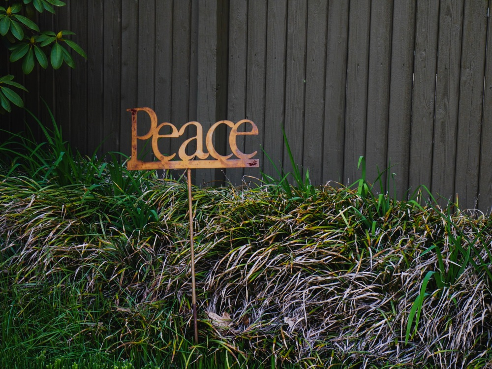 "A lawn ornament which simply states, ""Peace."""