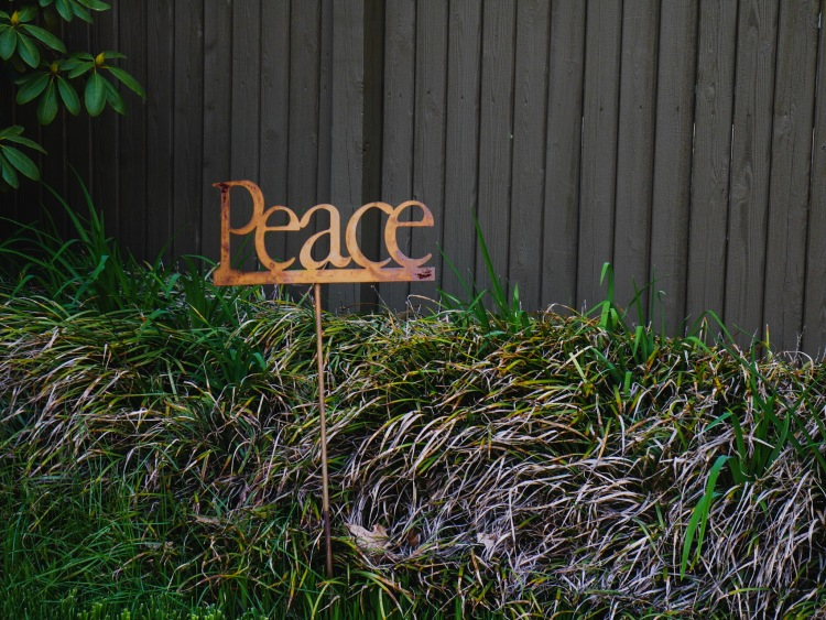 """A lawn ornament which simply states, """"Peace."""""""