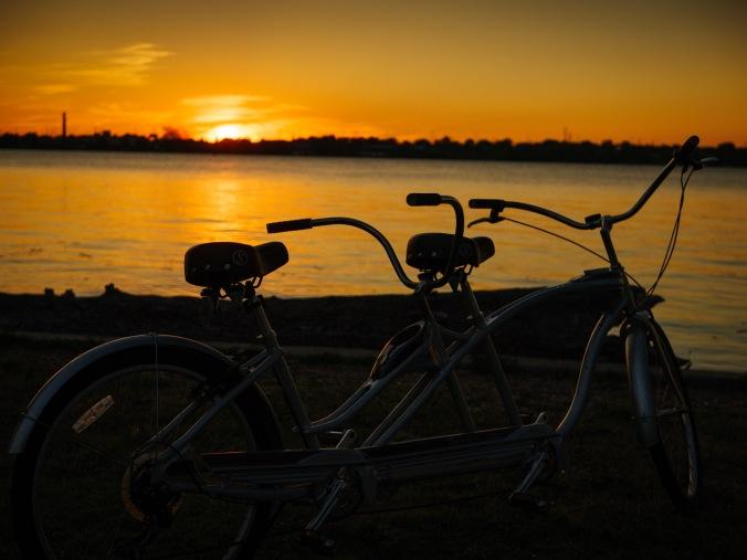 A tandem bike as the sun sets.
