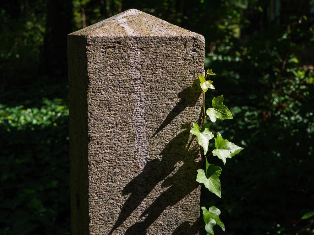 An old pillar with serious shadows.