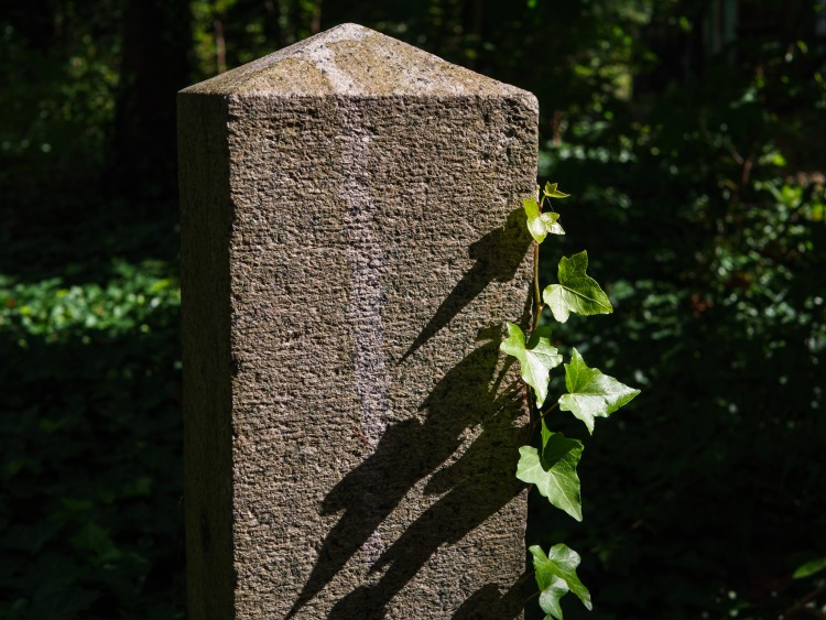 An old pillar with serious shadows.