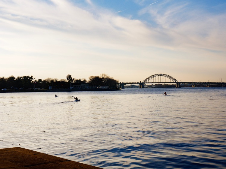 Kayakers paddle down toward the Tacony-Palmyra Bridge