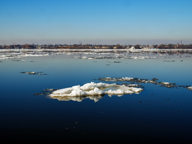 River ice melts on a warm February day