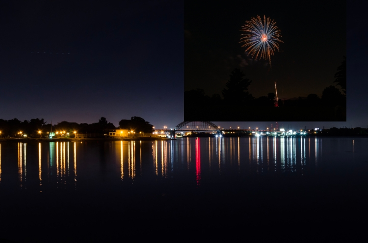 Nighttime photo of the Tacony-Palmyra Bridge. An unmasked firework photo is in the sky.