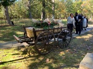 A woven bamboo casket, on a hand drawn cart